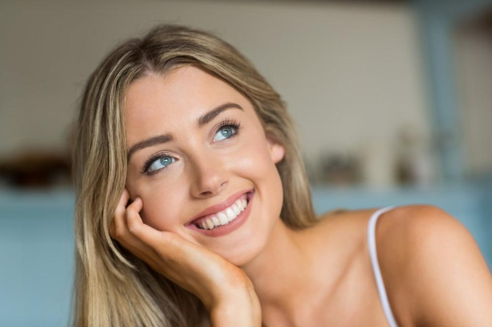 female smiling dental patient | cosmetic bonding pikesville md
