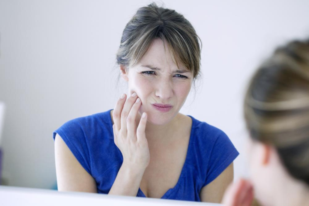 woman with tooth ache | emergency dentistry baltimore