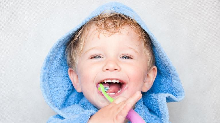 Kid brushing teeth | Naylors Court Dental Partners