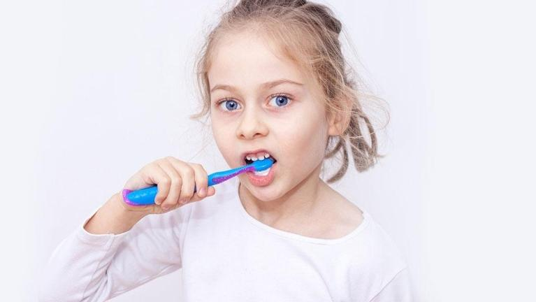 Young girl brushing her teeth l Children's Dentistry Pikesville MD